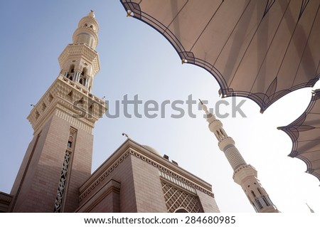 MEDINA, SAUDI ARABIA-CIRCA MAY 2015: Beautiful fisheye view of Nabawi Mosque from lower angle in the evening on MAY, 2015 in Medina, Saudi Arabia .This mosque is the second holiest mosque in Islam. - stock photo