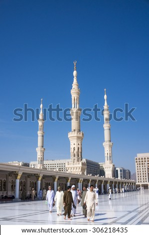 MEDINA, SAUDI ARABIA-DEC 19, 2014 : Exterior view of Muslims after prayer in Medina, Saudi Arabia. This is second holies mosque in Islam. - stock photo