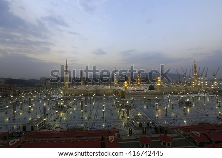 MEDINA, SAUDI ARABIA-DECEMBER 18, 2015: Unidentified Arab muslim walks on the compound of Nabawi Masjid (mosque) in Medina, Kingdom of Saudi Arabia.