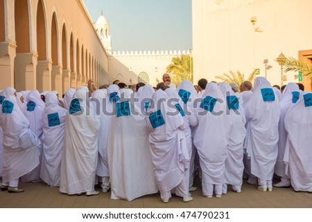 MEDINA, SAUDI ARABIA-DECEMBER 20 2014 : Unidentified pilgrims at Bir Ali mosque (Zulhulaifah) in Medina. This is a miqat area (place and time for Ihram) for pilgrims who enter Mecca from Medina.