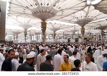MEDINA, SAUDI ARABIA - JAN 30: After Friday prayers, Muslims gathered in front of the mosque of the prophet on January 30, 2015 in Medina, KSA. Nabawi Mosque is the second holiest mosque in Islam - stock photo