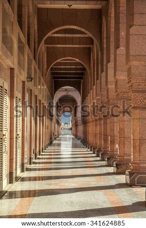 MEDINA, SAUDI ARABIA (KSA) - JANUARY 30: Arches of ancient porch behind the mosque and tomb of the prophet January 30, 2015 in Medina, KSA. - stock photo