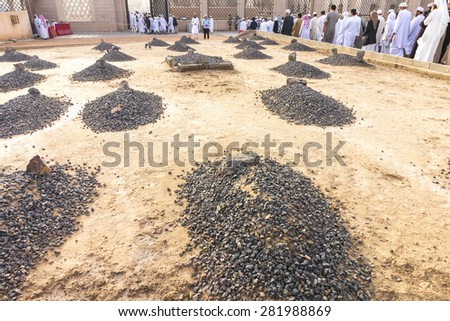 MEDINA, SAUDI ARABIA - MAR 08: Baqee grave outside Nabawi Mosque at March 08, 2015 in Medina, Saudi Arabia. Jannat Al-Baqee is one of the largest cemeteries in the Muslim world. - stock photo