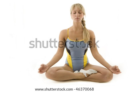 Meditating attractive young woman. - stock photo