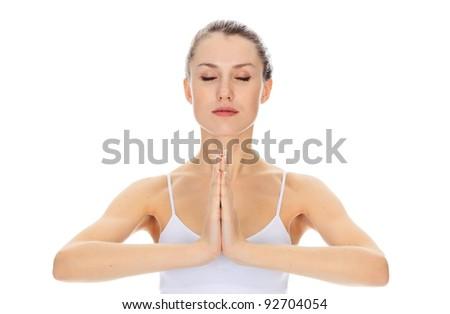 meditating girl posing against white background - stock photo