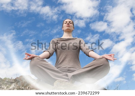Meditating in the clouds - stock photo