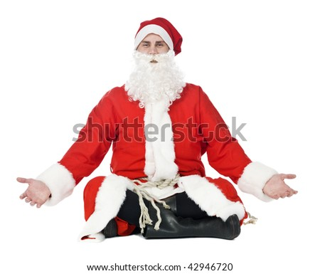Meditating santa claus isolated on a white background - stock photo