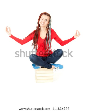meditating young student girl with books, full length, white background - stock photo
