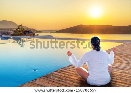 Meditation at sunrise in Greece - stock photo