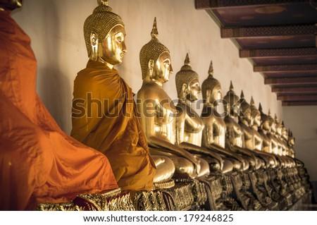 Meditation. Buddha statues ina  row at Wat Arun in Bangkok, Thailand. - stock photo