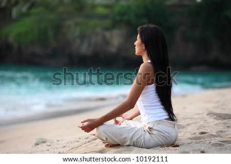 meditation by the beach - stock photo
