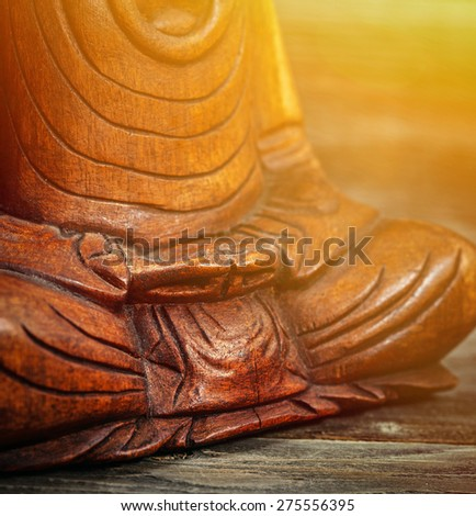 Meditation conceptual image with focus on Buddhas hands - stock photo