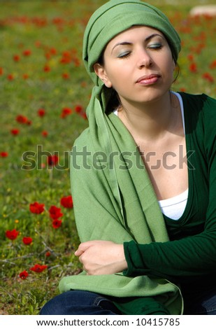 Meditation, in a pretty field of red flowers