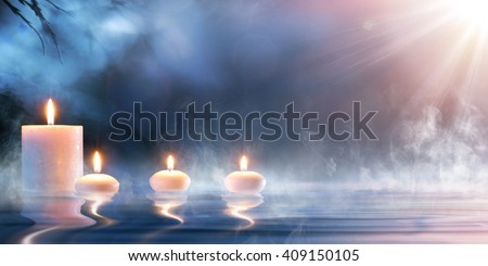 Meditation In Spiritual Zen Scenery - Candles On Thermal Water  - stock photo