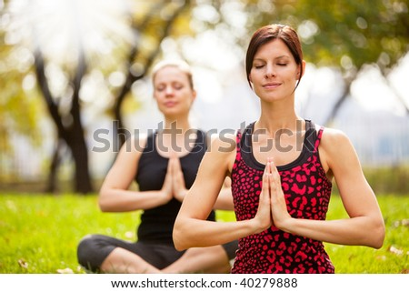 Meditation in the a park on a warm summer day - stock photo