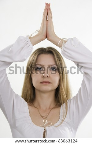 Meditation of the young woman. White isolation. - stock photo