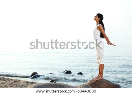 meditation on ocean sand - stock photo