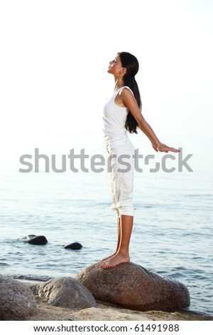 meditation on ocean sand beach - stock photo