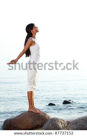 meditation on ocean sand beach - stock photo
