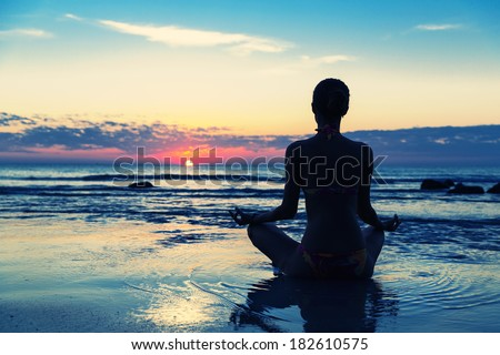 Meditation on the beach - stock photo