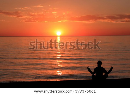 Meditation on the beach at sunset