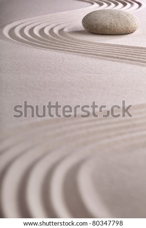 meditation zen garden japanese garden zen stone with raked sand and round stone tranquility and balance ripples sand pattern - stock photo