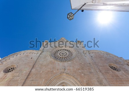 mediterian scenic witch sun, blue sky  and church - stock photo