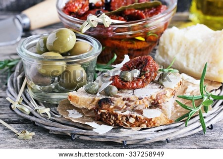 Mediterranean appetizers on a rustic wooden table.Selective focus - stock photo