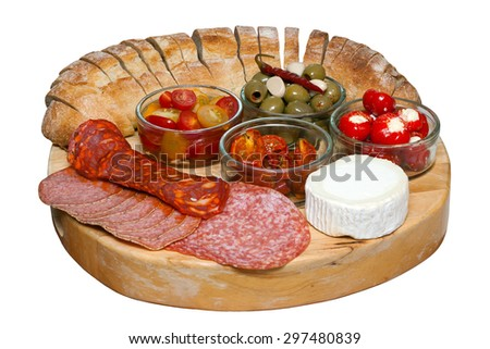 Mediterranean assorted antipasti on a wooden board with an isolated white background and clipping path - stock photo