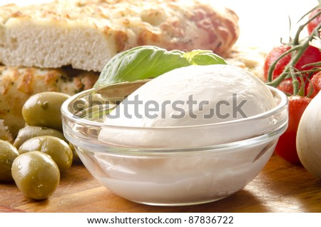 mediterranean breakfast with mozzarella, olives and spicy bread - stock photo