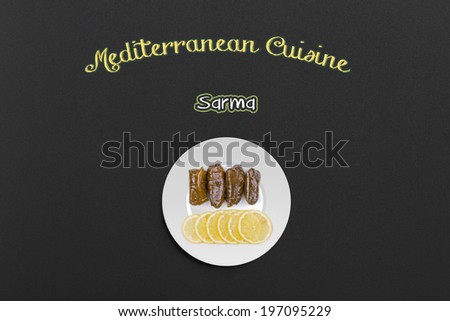 Mediterranean Cuisine Concept with Sarma - Rice and Mint Wrapped in Grape Vine Leaves on a Chalkboard. - stock photo