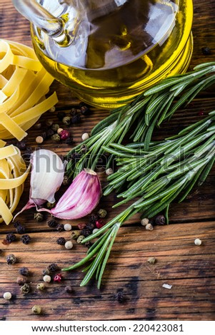 Mediterranean cuisine Pasta tagliatelle penne pepper thyme garlic cherry tomatoes and olive oil.Macro concept  - stock photo