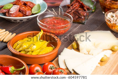 Mediterranean cuisine. Spanish tapas starters on wooden table. Selective focus