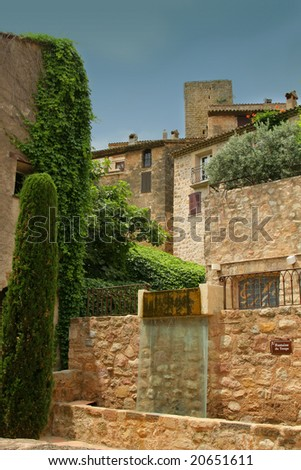 Mediterranean façades in an old village from the Middle Ages in the south of France. - stock photo