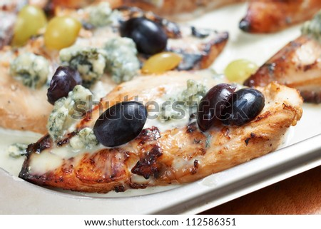 Mediterranean food of Provence, chicken fillet roasted with blue cheese, grapes and olives