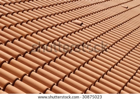 Mediterranean house roof style with ventilation holes - stock photo