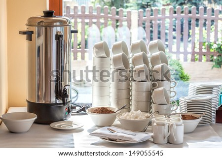 Mediterranean interior - a silver coffe maker, cups and ingredients
