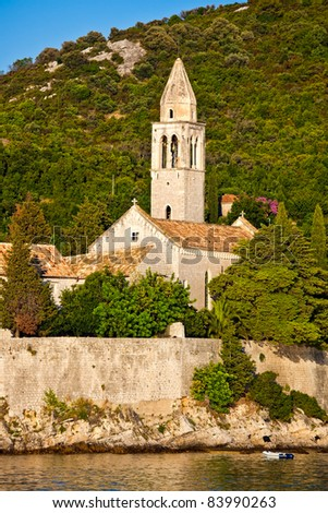Mediterranean landscape at sunset. Island Lopud near Dubrovnik, Croatia. Old monastery with bell tower - stock photo