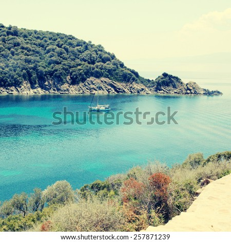 Mediterranean landscape with beautiful turquoise bay, Ammouliani island, Halkidiki. Square toned image, instagram effect - stock photo