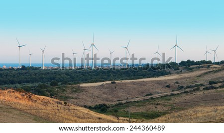 Mediterranean landscape with wind turbines - stock photo