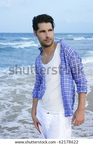 Mediterranean latin young man on summer blue beach walkling relaxed
