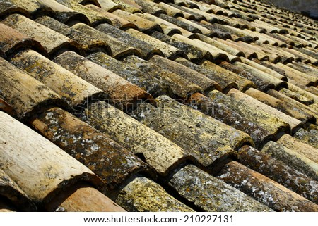 Mediterranean old roof tiles on the roof of an old house - Dubrovnik - stock photo