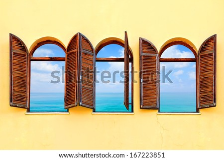 Mediterranean open windows with shutters and sea panoramic view - stock photo