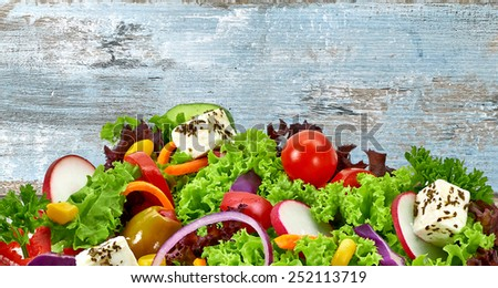 Mediterranean salad with feta cheese detail on grungy background with copy space - stock photo
