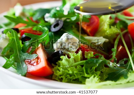 Mediterranean salad with gorgonzola and olive oil - stock photo