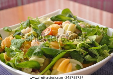 Mediterranean salad with shrimp, cheese and pasta - stock photo