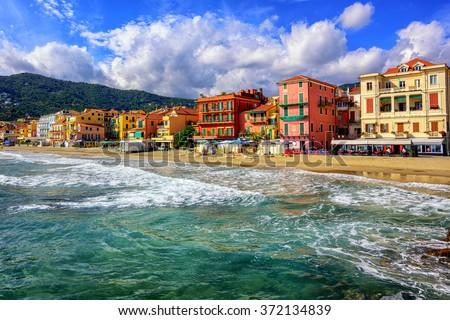 Mediterranean sand beach in traditional touristic town Alassio on italian Riviera by San Remo, Liguria, Italy - stock photo