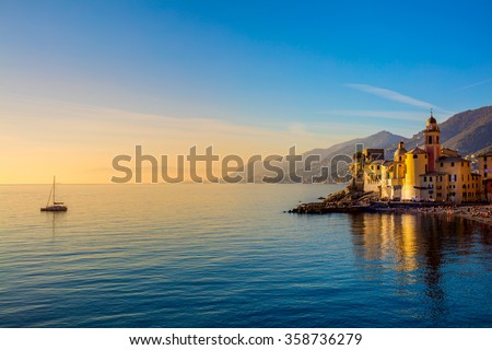 Mediterranean Sea at sunrise, small old town and yacht - Europe, Italy, Camogli - stock photo