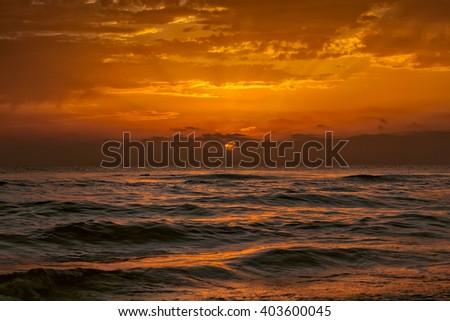 Mediterranean Sea orange sunset on the beach - stock photo