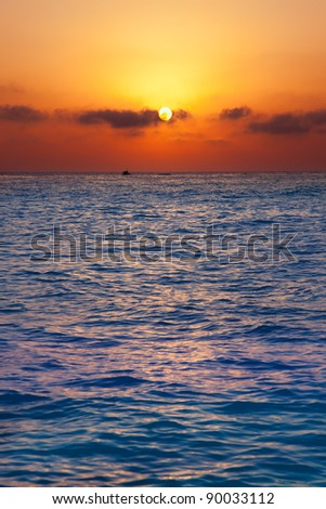 Mediterranean sea sunrise sunset with sun in orange sky - stock photo